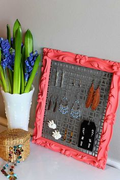 Quick and Easy DIY earring holder out of aluminum sheet from hardware store and a thrift store frame. A great repurposing project for both hoops and studs!