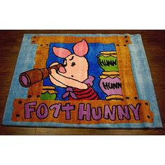 Little fans of Winnie the Pooh will love this cute kids rug featuring everyone's favorite stuffed pig. The image of Piglet on the lookout is sure to delight adults and children alike, and the low pile keeps the rug looking good through heavy use.