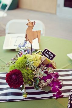 Animal themed wedding at the zoo! How cute, tell people your seated at the tiger table or the elephant table! so cute