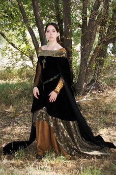 This beautiful dress was inspired by a woman featured in the manuscript Très Riches Heures du Duc de Berry. The one-of-a-kind outfit is comprised
