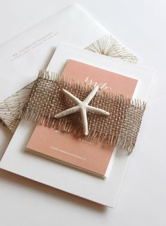 Perfect for a beach/tropical wedding: Gold Calligraphy Wedding Invitation Suite. With a starfish.