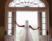 Caroline's monogrammed cathedral length veil