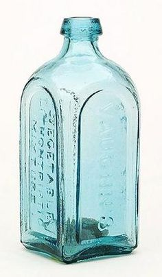 Vaughn's Vegetable Lithontriptic Mixture, Buffalo, Arched Panels, Blue Green, 8 inch A Vaughn's Vegetable Lithontriptic Mixture medicine bottle in light blue green with iron pontil mark
