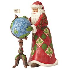 4053708 Joy Is In The Journey (Santa with globe)- Santa plans his Christmas Eve journey in this colourful creation featuring the folk-art style that is unmistakably Jim Shore #Christmas #Santa #JimShore