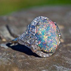 This magnificent 1920s opal ring at EraGem.com
