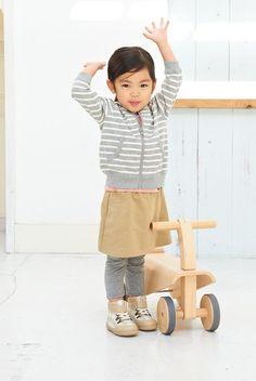 A cute little girl in Muji outfit