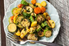 Break out the veggies and whip up some lovely Herb Roasted Zucchini and Carrots! The cooking time adds to its flavor. A great way to use up the garden's excessive amount of zucchini and summer squash! Roast Zucchini And Carrots, Carrot Zucchini Recipe, Carrot Recipes, Vegetable Recipes, Vegetarian Recipes, Cooking Recipes, Healthy Recipes, Cooking Time, Roasted Zuchinni