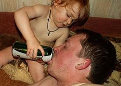 Chug Chug Chug! In this picture: A little kid helping her dad chug a beer