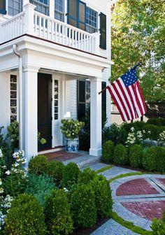 front entrance. white house/ black shutters.