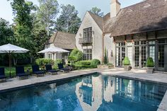 The careful placement of outdoor furnishings provide balance to the architectural wing of the home, which flanks the pool on the opposite side.