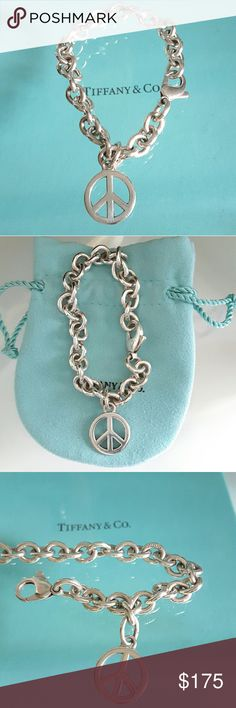 """Tiffany & Co Peace Circle Charm Pendant Bracelet Tiffany & Co Silver Peace Circle Charm Pendant Link Bracelet Bangle    Silver bracelet with  the peace charm  The length is 7"""" the size of the charm is 5/8"""" in diameter.  Engraving: """"TIFFANY & CO 925"""" (as shown in the picture)  Engraving on the 925 circle clasp and T&CO 925""""he middle link of the bracelet  100% AUTHENTIC  Tiffany & Co box and pouch NOT included Tiffany & Co. Jewelry Bracelets"""