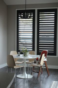 New black plantation shutters in our breakfast nook!  Austin Window Fashions.