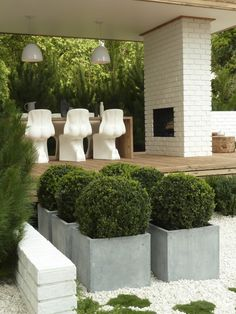 'Cheeky' seats, cypress decking with crisp whites and dark green Scandinavian inspired plants