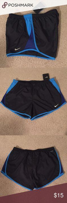 Nike Dri-fit running shorts. PRICE IS FIRMBRAND NEW WITH TAGS. Nike running shorts. Dri-fit moisture wicking technology. Reflective Nike logo. Drawstring elastic waistband.                                                       TRADESPPMERCARI Nike Shorts