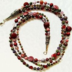 Maggies Beadery one of a kind mauve and pink gemstone multi-strand beaded necklace is 21 inches long. This fastens with sterling silver cones and a large sterling silver lobster clasp.