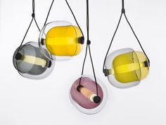 Brokis - Line: CAPSULA. Designer: Lucie Koldová Lucie Koldova Studio Paris. The design resembles cells or plant seeds and evokes the metaphor of light as the source of life. M: crystal-clear glass outer shell + internal capsule of colored glass + tubular LED light source