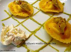 Ravioli di burrata con crema ai carciofi e nocciole