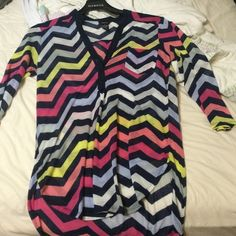 Casual blouse Rue 21 colorful light weight blouse. This would be a good shirt for the beach because it is breezy Tops Blouses