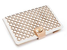 A delicately constructed leather jewelry case, the Chloé accentuates the beauty of leather and pattern combined.