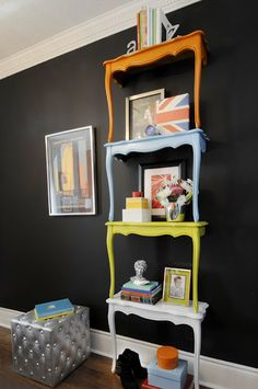 Table Shelves. Multi-colored. Black wall.