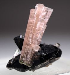 Very Beautiful Pink Tourmaline With Smoky Quartz Specimen From Pakistan Dont Miss. Product: Tourmaline Specimen Orign: Skardu Pakistan Shape: Mineral Specimen. Size: 32 x 16 x 38 mm Weight: 50 Cts Treatment: Natural.