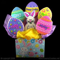 Vibrant colours on adorable Easter egg cookies with bunny in basket for Spring