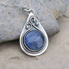 Handmade Sterling Silver Bezel Set Kyanite Teardrop Pendant Necklace with Iolite. $56.00, via Etsy.