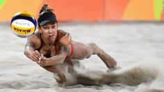 Canada's, Jamie Lynn Broder dives for the ball during a beach volleyball match on Sunday, August 7.