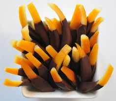 Chocolate-covered orange peels. Kind of healthy alternative for the holidays. Would be a great hostess gift!