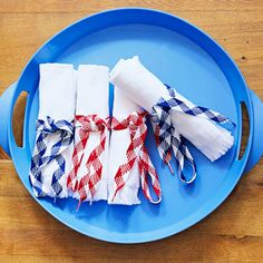 Easy red, white and blue decor: Tie up terry-cloth hand towels with red and blue shoelaces for oversize napkins. More red, white and blue projects: http://www.midwestliving.com/homes/seasonal-decorating/summer-easy-project-ideas/