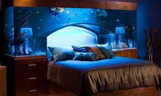 Amazing Aquarium #Bed with two bedside lamps inside the 650-gallon headboard tank.. Happy sleeping with the fish! #decor
