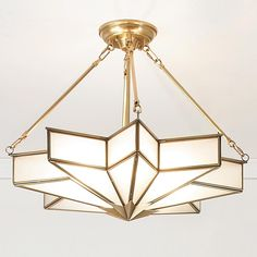 """Frosted Glass Star Chandelier The magic of the Hollywood deco era comes alive in this unique star flush chandelier in glare free frosted glass trimmed with golden brass. Convertible to semi-flush mount. 4x60 watt medium. (22""""Hx25""""W)"""