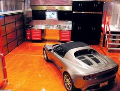 A cool garage with a work area and plenty of room to park my favorite cars. #StorageMart #OrganizeIt