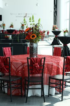 Linens and Chairs from Diamond Rental with floral from Brown Floral.
