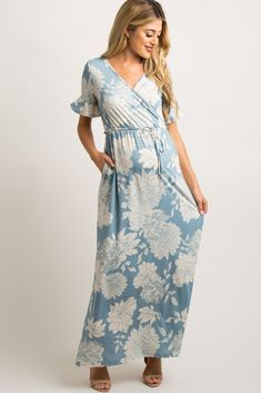 0463e7e285662 Light Blue Floral Print Ruffle Sleeve Maxi Dress A floral print maternity  maxi dress featuring a wrap v-neckline, a cinched elastic waistline, short  sleeves ...