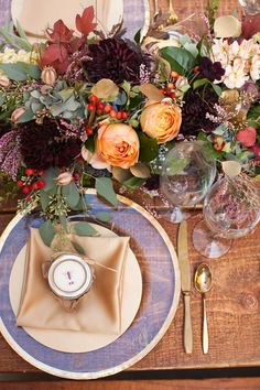 Add opulence to an autumn wedding with gold detailing - love the clash of orange roses and dark dahlias too! Wedding decor, tablescape, centerpiece