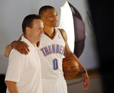Coach Scott Brooks, left, and Russell Westbrook pose for a photo during media day for the Oklahoma City Thunder NBA basketball team at the Thunder Events Center in Oklahoma City, Monday, Oct. 1, 2012.  Photo by Nate Billings, The Oklahoman - I love this pic!!!