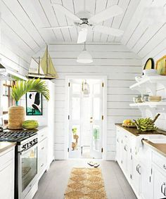 A monochromatic color scheme works in a smaller space. Paint your walls and cabinets white to achieve this look.