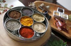 The ayurveda spices of life are turmeric, whole mustard seeds, roasted cumin seed powder, dry mango powder, red chili powder, coriander seed powder and whole cumin seeds.