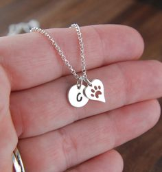 Small initial and heart shaped paw print charm necklace in sterling silver, heart charm, cat paw, dog paw, cat jewelry, dog jewelry, pets by jersey608jewelry on Etsy https://www.etsy.com/listing/171308145/small-initial-and-heart-shaped-paw-print