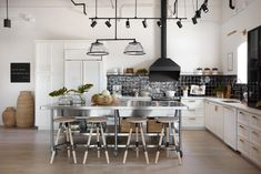 This kitchen feels like it belongs in an apartment in Manhattan, which is perfect for Catherine. The kitchen island is on wheels which not only works so well in this apartment, it also gives Catherine plenty of room to spread out and cook...or dance as Chip would suggest.
