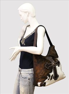 The Crazy Heifer - Raviani Leather Cross, $332.00 (http://www.thecrazyheifer.com/raviani-leather-cross-handbag/)