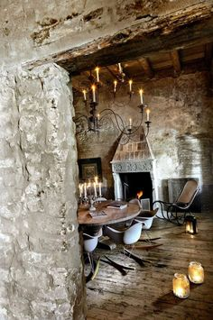 Rustic Stone Dining Room. Love it! Except the chairs. They're funny and unique, but not my style. I'd like this room, with a big bold dining room table, and gnarly old wood and leather chairs.