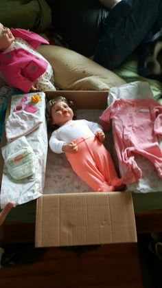 Baby lily in her box with her extras. A bubbles and teacups package.