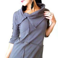 This unique top is handmade completely from scratch, an original design and one of a kind.I made this piece using solid gray cotton/lycra knit fabric. I gave it a great shape with a gently tapered waist and flaring just a bit at the hips for total comfort. I gave it super comfortable fitted 3/4 sleeves and a generous asymmetrical cowl with an opening at one side. I made pin-tuck stitches running up and down the sleeves, from the opening on the cowl neck on the front and an asymm...