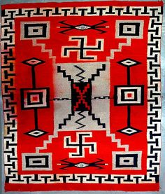 This blanket dates to 1920 from Chinle. Called a storm pattern, it includes a fret border and both left and right facing swastikas. [Navajo]