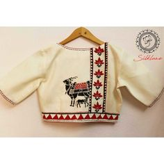 Hand painted blouse with sanjhi cow design and kantha embroidery – Hand painted … - Blouse designs Cotton Saree Blouse Designs, Best Blouse Designs, Blouse Back Neck Designs, Choli Blouse Design, Designer Blouse Patterns, Skirt Patterns, Coat Patterns, Clothes Patterns, Sewing Patterns