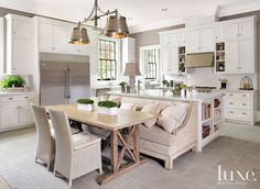 .White Glass Subway tile backsplash.  Love the couch seating added on with table seating