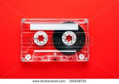 Audio tape cassette on red background