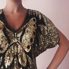 Vintage 1970s Sequined Butterfly Top Solid gold. This top is a party top! Straight from the 70s you will stand out in this fun butterfly shape. Good condition, amazing detail. Vintage Tops